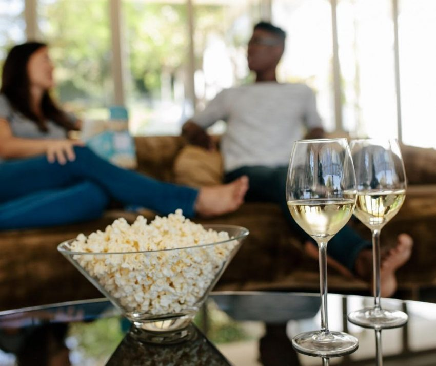 Quarantine wine pairing snacks include popcorn and movie night at home.