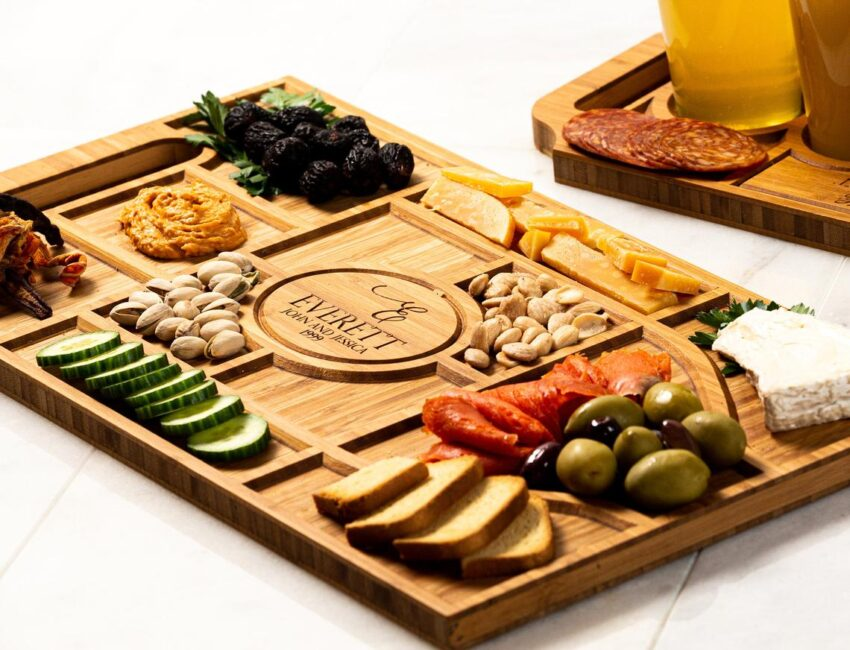 Gift your entertaining wine-loving fiends with a personalized charcuterie board. Photo Etsy